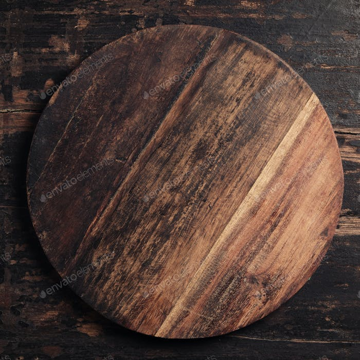 Wooden cutting board on rustic background