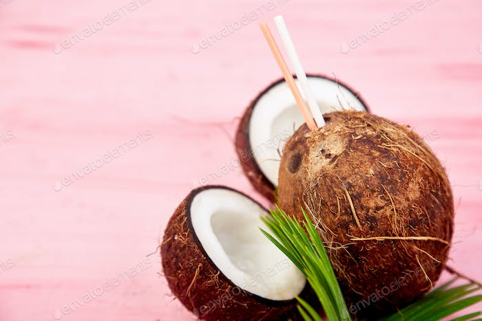 Coconut cocktail on pink background. Summer holiday drink