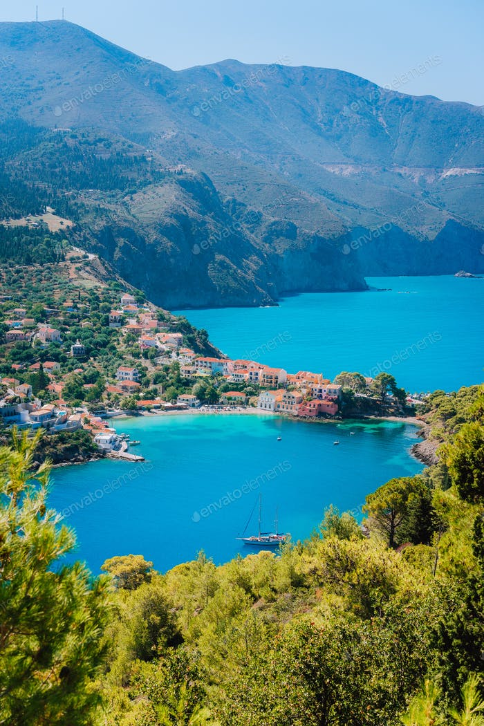 Mediterranean seashore in Greece. Beautiful turquoise colored Assos bay water surrounded by pine and