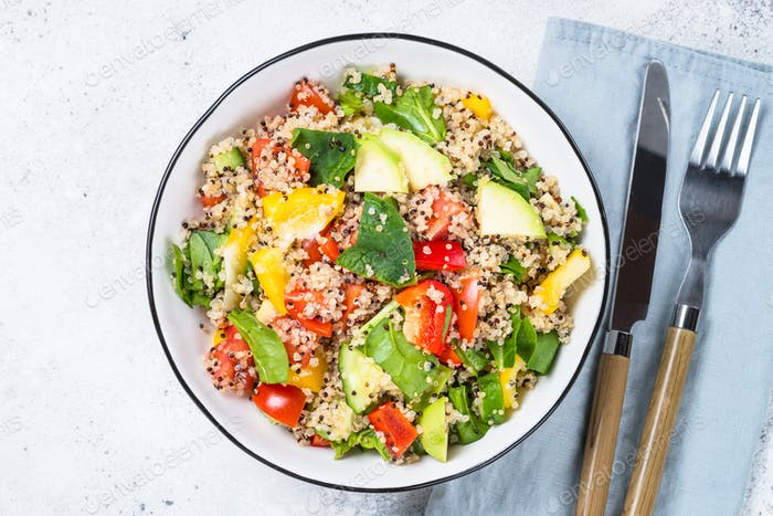 Quinoa salad with fresh vegetables on white
