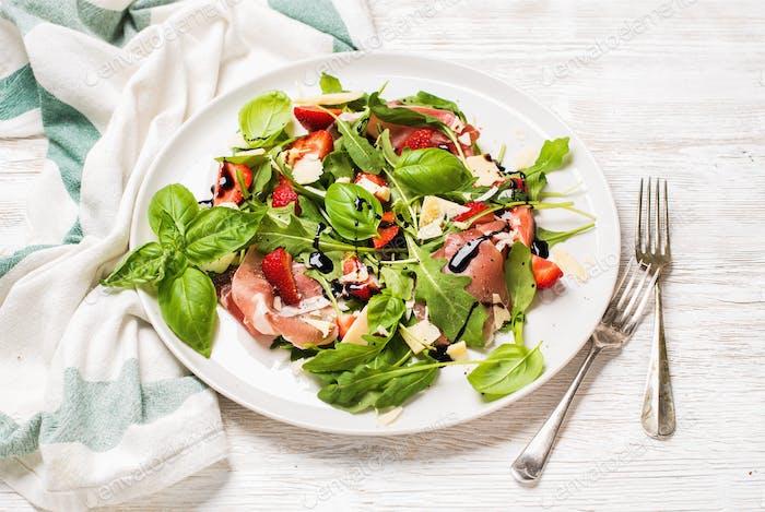 Summer arugula, prosciutto and strawberry salad