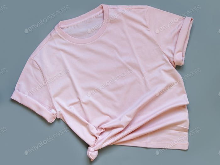 Place it - Pink t-shirt mock up flat lay on grey background