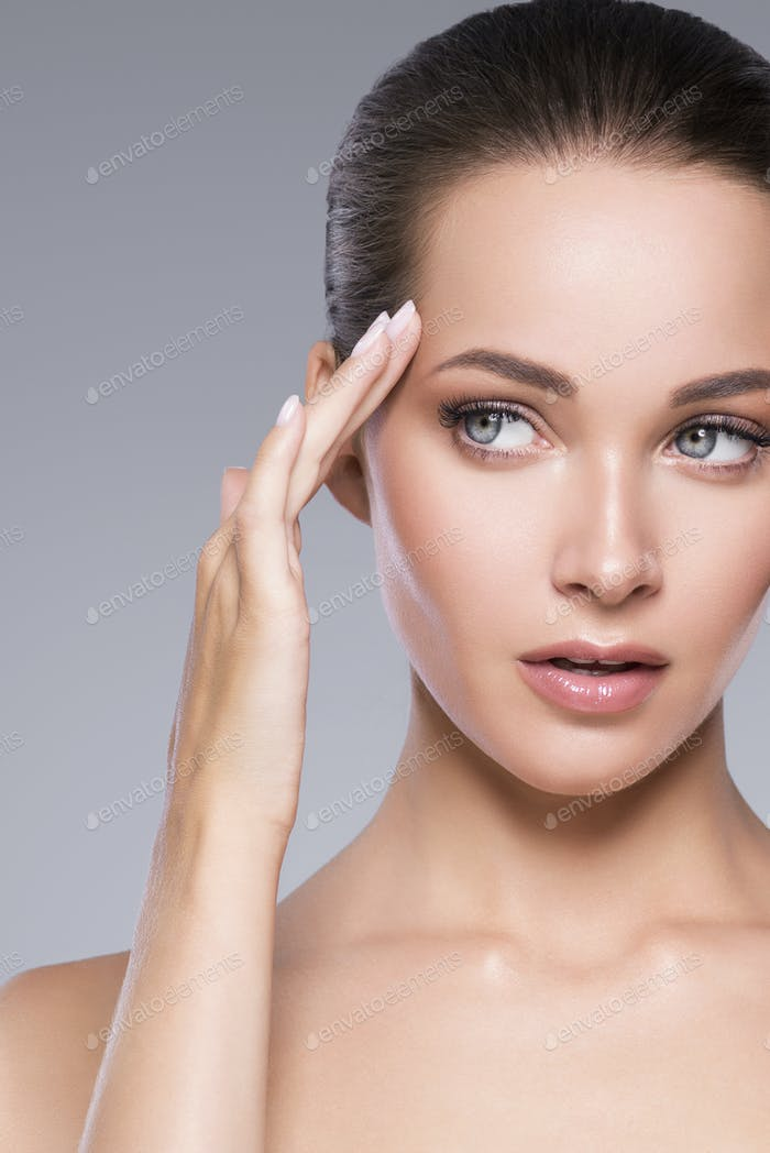 Skin care woman beauty face healthy face skin cosmetic model emotional and happy with hands
