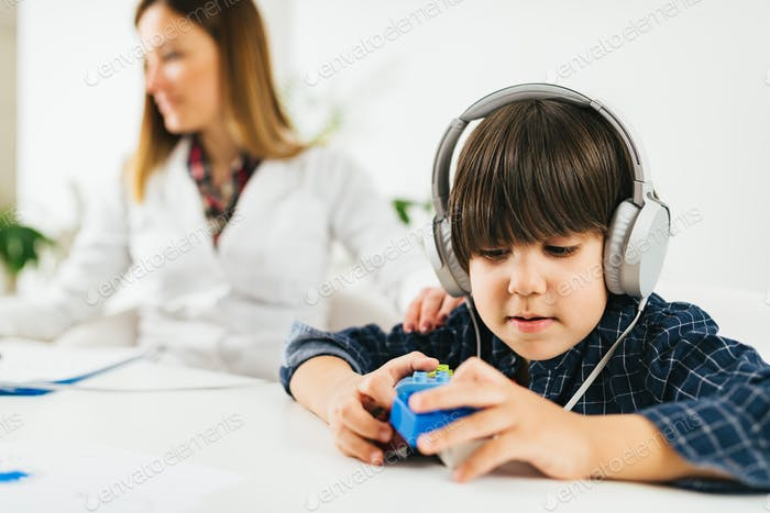 Hearing Test for Children - Little Boy Doing a Audiometry Test