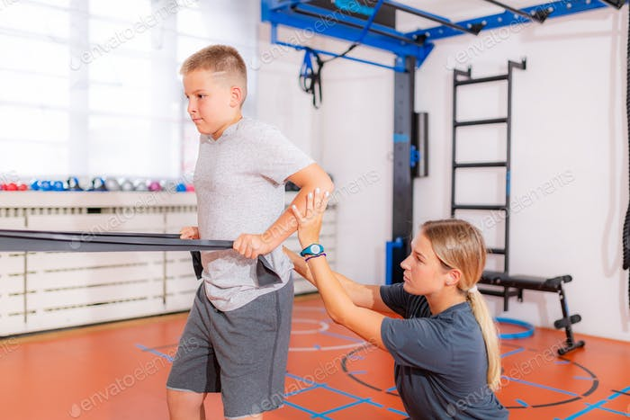 Shoulders and back exercise for children with resistance bands