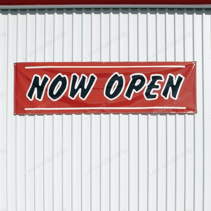 Grand Opening Sign on Aluminum Siding