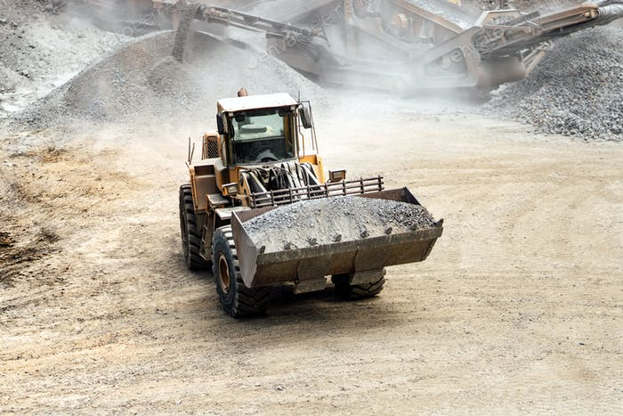 heavy duty excavator working at quarry moving gravel and rocks