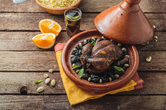 Chicken tajine with prunes and almonds, moroccan cuisine, copy space