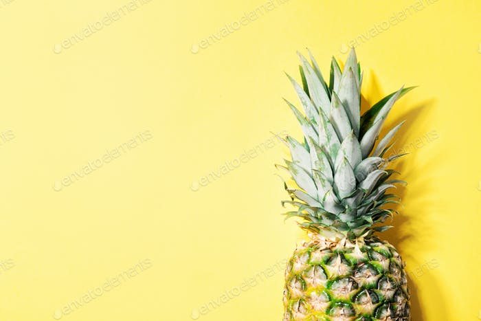 Pineapple on yellow color background