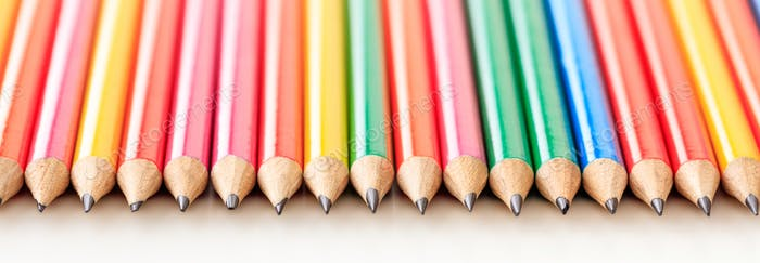 Colorful pencils on white color background, banner