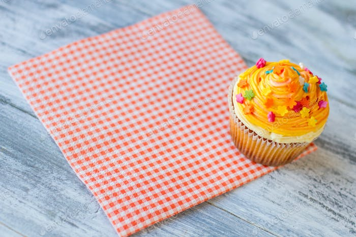 Cupcake on red checkered napkin