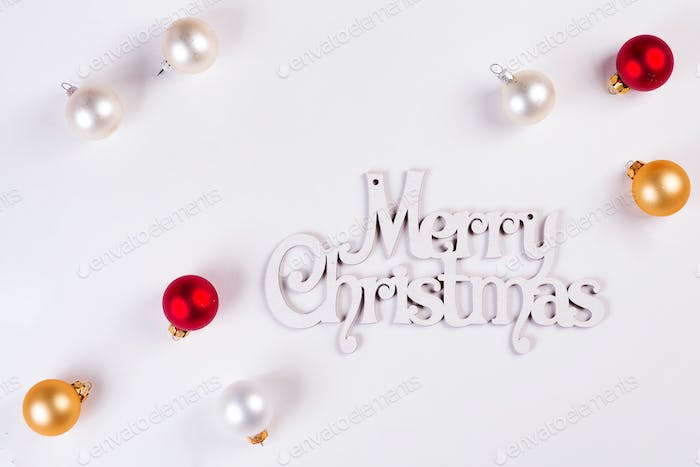 Christmas Holiday Balls and letter Merry Christmas isolated on a white background