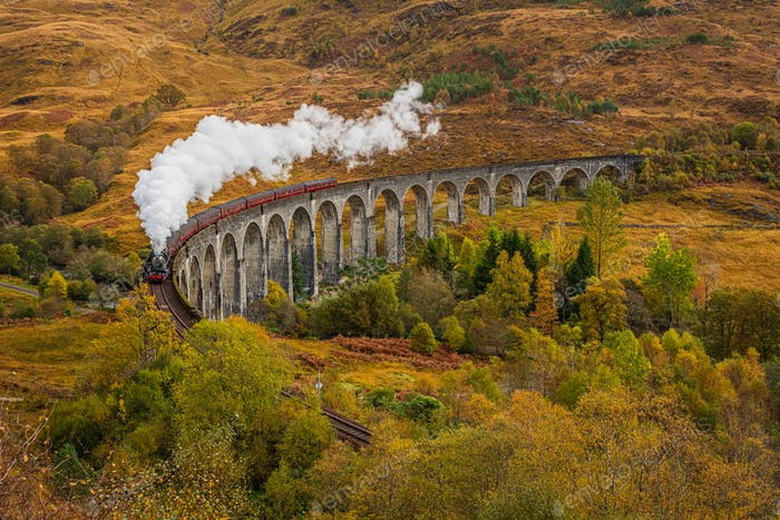 Old Fashioned Steam Train with Air Whistle on Glenfinnan Viaduct, Scotland in Autumn