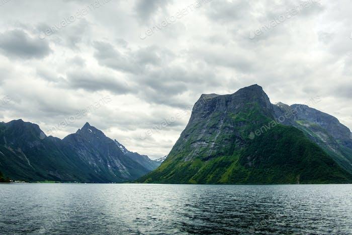 Dramatic evening view of Hjorundfjorden fjord