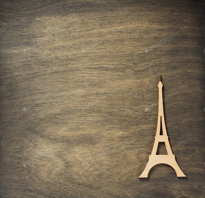 eiffel tower toy at plywood background surface