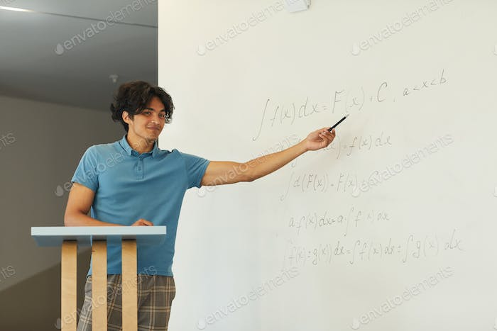 Explaining math solution at blackboard