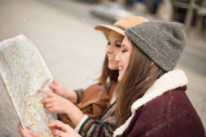 Friends consulting a city map