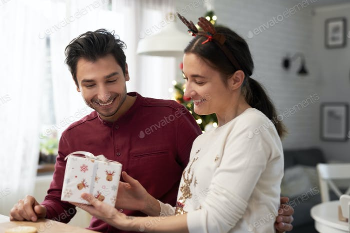 Cheerful couple with Christmas presents