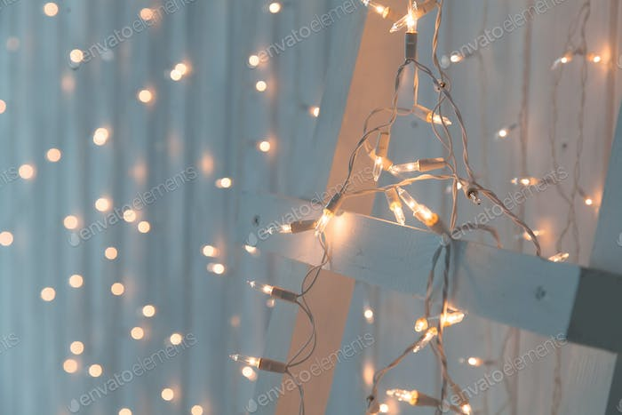 Christmas Lights Burning On A White Wooden Background New Year Back