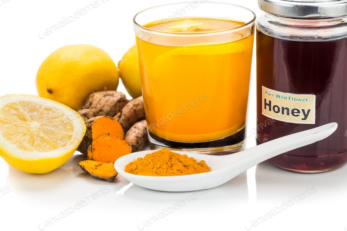 Turmeric roots with lemon and honey drinks, powerful healing bev