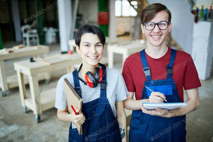 Satisfied students in carpentry classroom