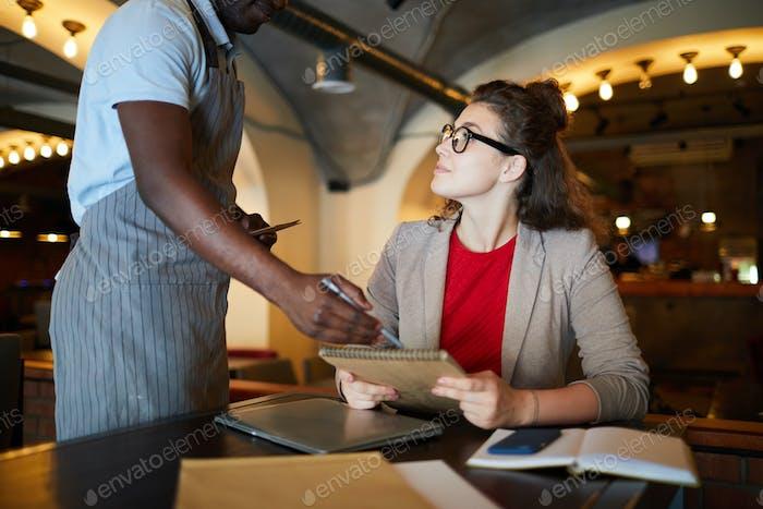 Businesswoman and waiter