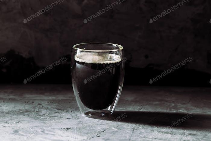 Espresso coffee in shot glass sepia tone with soft shutter