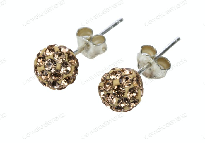 Silver earrings with golden crystals isolated