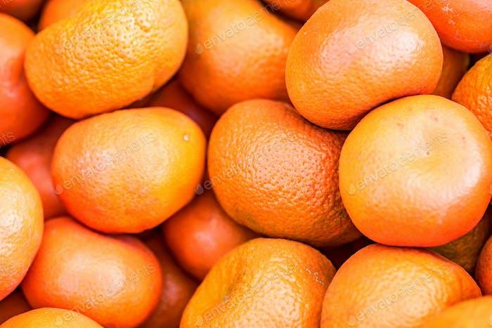 Nahaufnahme viele helle Mandarinen Hintergrund
