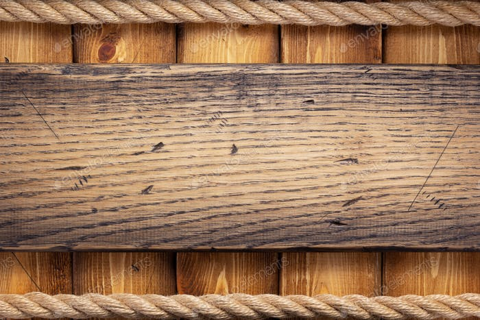 ship rope border at wooden background
