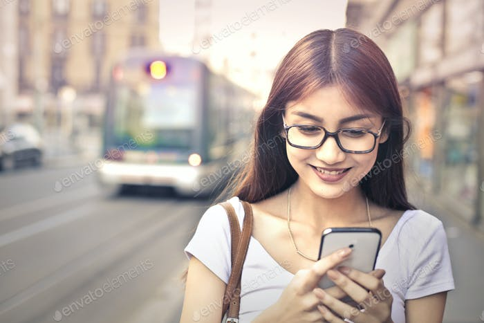 Girl with a smartphone outdoor