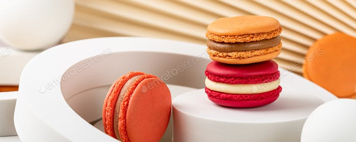 Cake macaron or macaroon on beige background
