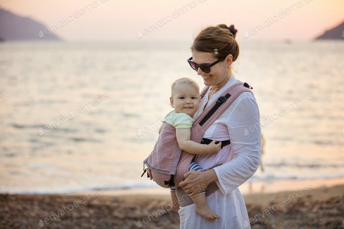 Cheerful Caucasian woman with little daughter
