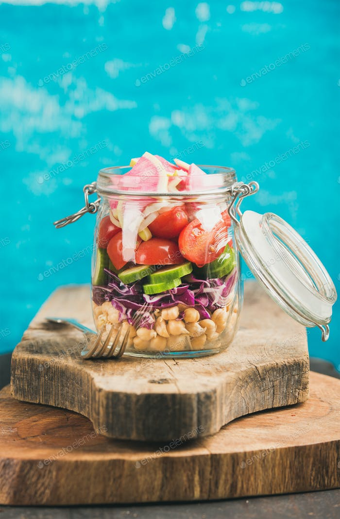 Vegetable and chickpea sprout vegan salad in jar, copy cpace