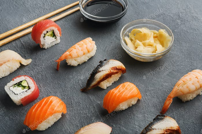 Sushi and rolls on gray background