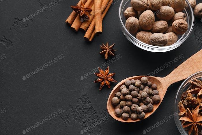 Nutmeg, cinnamon sticks, badyan and pepper closeup