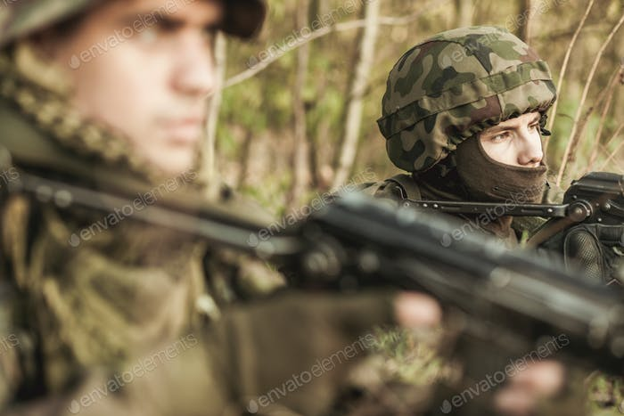 Masked soldiers with weapons outdoor