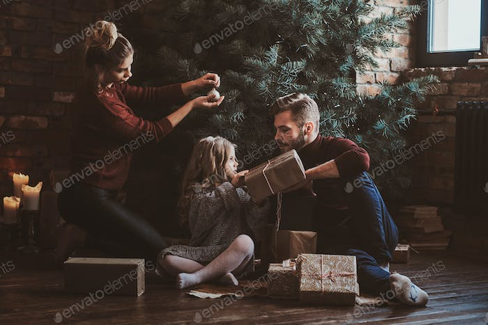 Happy family is celebrating Christmas at home