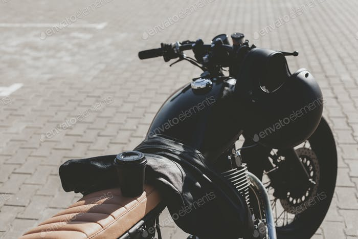 Cup of coffee on motorcycle