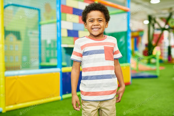 Laughing African-American Boy in Play Center