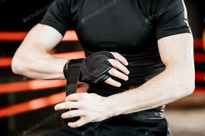 Boxer winding bandage on the wrists