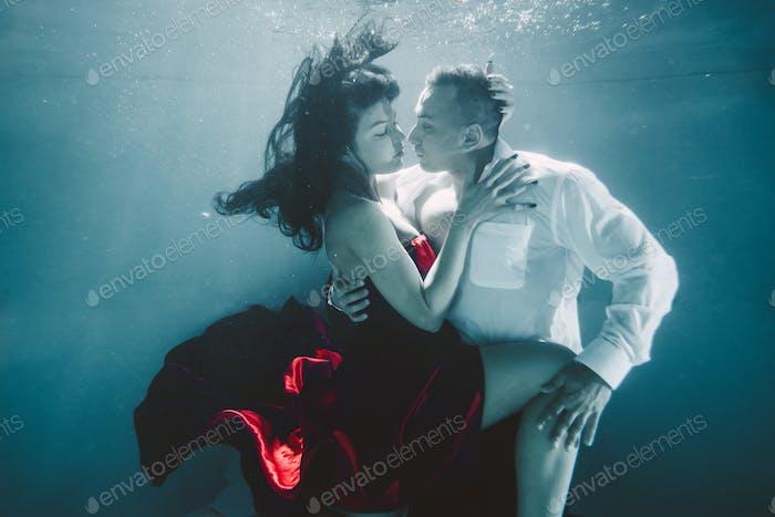 Couple swimming underwater