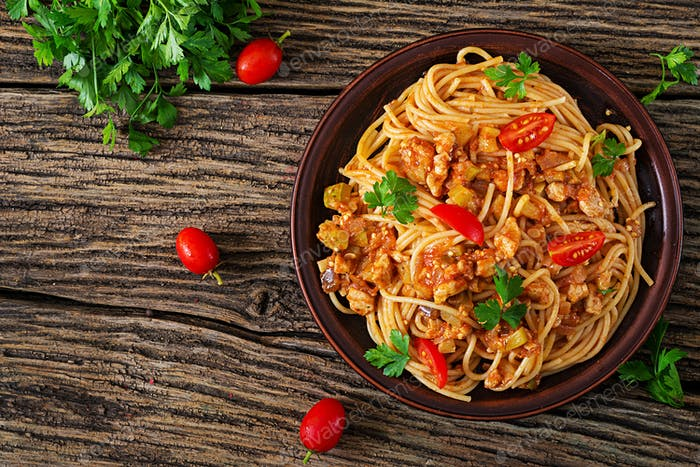 Spaghetti bolognese pasta with tomato sauce, vegetables and minced meat