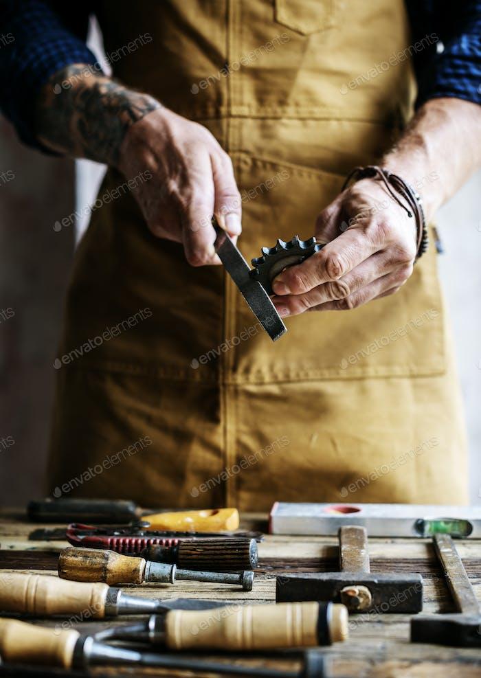 Closeup of carpenter man working with tools equipment set