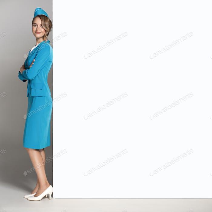 Portrait Of Charming Stewardess Wearing In Blue Uniform.