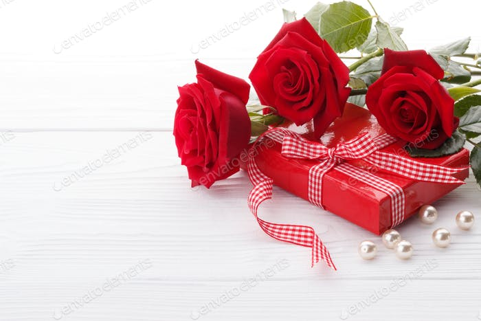 Red roses and a gift box