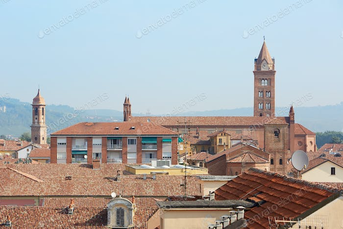 Alba rooftops with cathedral's bell tower view, Italy
