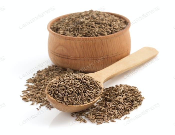 cumin seeds on white background