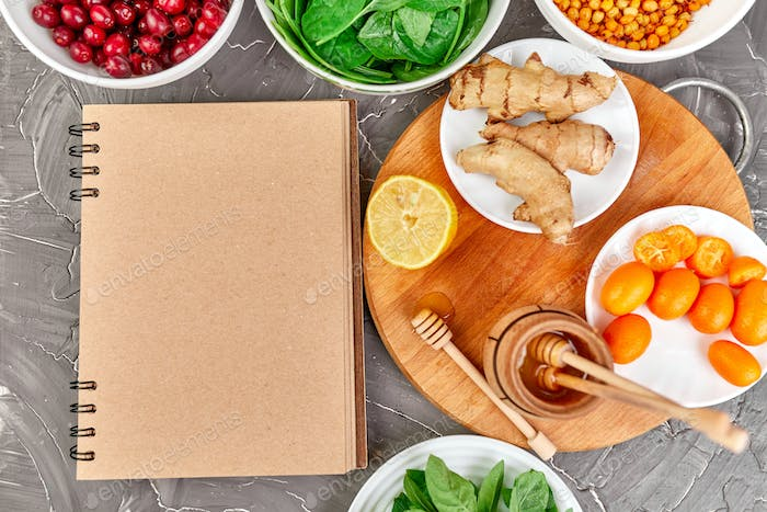 Notebook with healthy products, trendy virus protection food