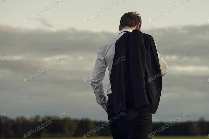 Downhearted businessman standing outdoors